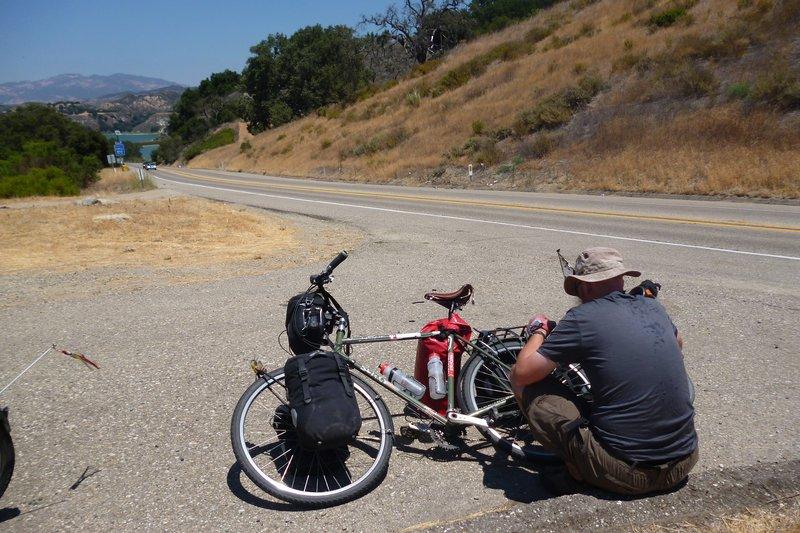 fixing broken spoke while cycle touring